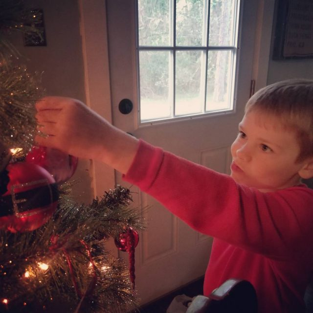 Deep in thought about where each ornament should go! momlifehellip